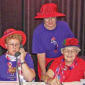 Ladies in red hats answering phones