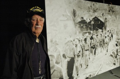 "Bataan Death March veteran Pedro ""Pete"" Gonzalez recognized himself in this photograph of the march, on the set of PBS New Mexico's Bataan: A 70th Anniversary Commemoration. (Photo: KNME)"