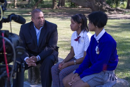 Tavis Smiley speaks with students Kenisha and Kenyatta in New Orleans during production of Education Under Arrest, one of two upcoming American Graduate specials on the drop-out crisis. (Photo: Gus Bennett)