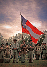 Confederate soldiers wave their flag before marching into battle in Civil War: The Untold Story. (Photo: Great Divide Pictures)