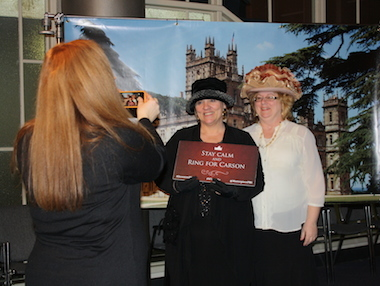 Fans pose in front of a Downton Abbey backdrop