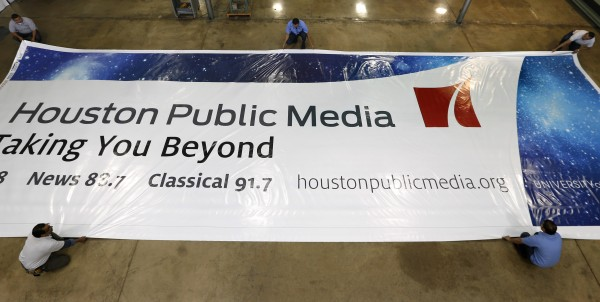 Workers prepare a billboard in 2014 for the launch of Houston Public Media's new brand and website. (Photo: HPM/Erich Schlegel)