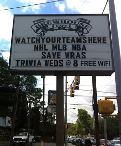 A local business displays a Save WRAS sign