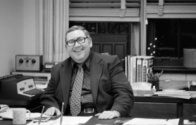 Donald Mullally at desk, historical photo