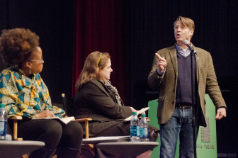 Filmmaker Whitney Dow addresses panelists. (Photo: Andrew Popper)