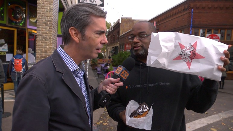 "Wild Travels host Will Clinger eyes an ""adult"" pastry from Voodoo Donuts in Portland, Ore. The new incarnation of a popular WTTW show takes Clinger beyond Chicago in search of quirky destinations. (Photos: Wild Travels)"