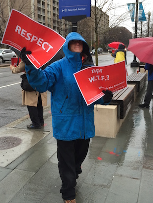 A protester shows support for NABET-CWA workers outside NPR headquarters Friday. (Photo: Dru Sefton, Current)