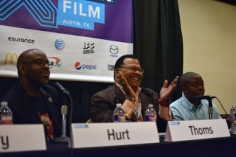 Donald Thoms VP Programming/General Audience, center, is flanked by filmmakers Byron Hurt, left, and Yance Ford, right, during a SXSW panel on indie filmmakers. Donald Thoms, PBS programming v.p., center, reacts to a comment from the audience during a SXSW panel on independent documentaries Tuesday. At left is filmmaker Byron Hurt; right, filmmaker Yance Ford. (Photo: Ben Mook, Current)
