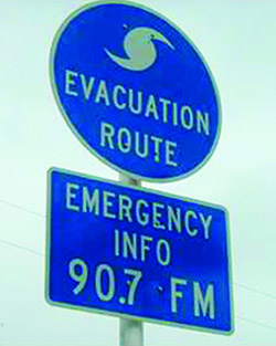 Under an emergency management partnership in Florida, road signs along evacuation routes point travellers to public radio frequencies where they can tune in for the latest updates. (Photo: Association of Public Media in Florida)