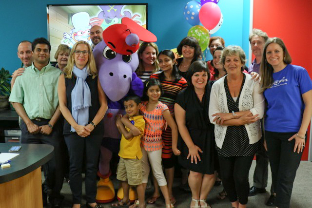 Trisha and her family pose with Cyberchase and Make-A-Wish staffers along with Digit, a character from the PBS Kids show. (Photo: WNET)