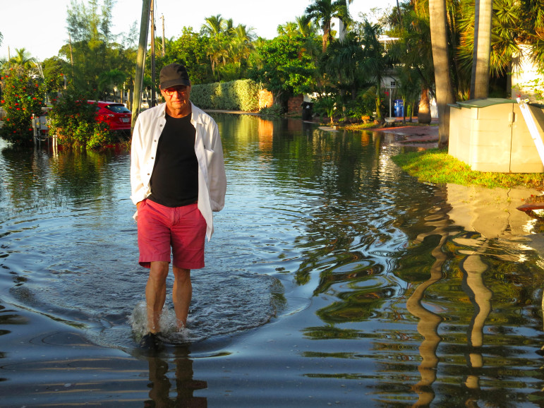 Chadwick walks down a flooded street in Fort Lauderdale, Fla., while reporting for Burn: An Energy Journal. (Photo: SoundVision Productions)