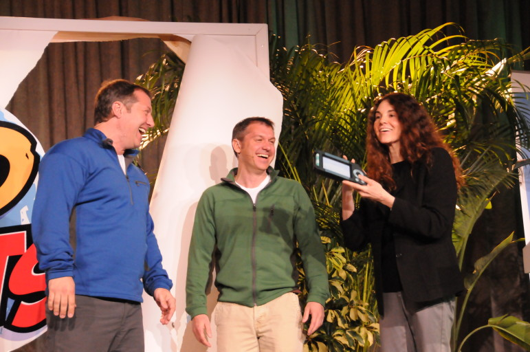 Martin, left, and Chris Kratt, hosts of Wild Kratts, join Simensky on stage during the 2010 PBS Annual Meeting. Their series is one of several in a new generation of PBS Kids shows for preschoolers.