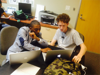 Donta Jackson (left) works with a fellow youth participant. (Photo: Youth Radio)