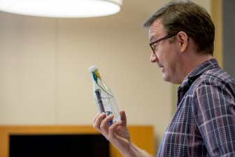 WVU Reed College of Media Innovator-in-Residence John Keefe shows a possible sensor design prototype to class on Monday, August 17, 2015. The class will use sensors to measure pollution levels in West Virginia waterways. (WVU Reed College of Media/David Smith)