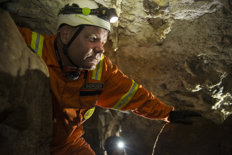 Lead researcher Lee Berger pushes deep into a South African cave in the Nova/National Geographic special Dawn of Humanity. (Photo: Robert Clark from the October 2015 issue of National Geographic magazine)