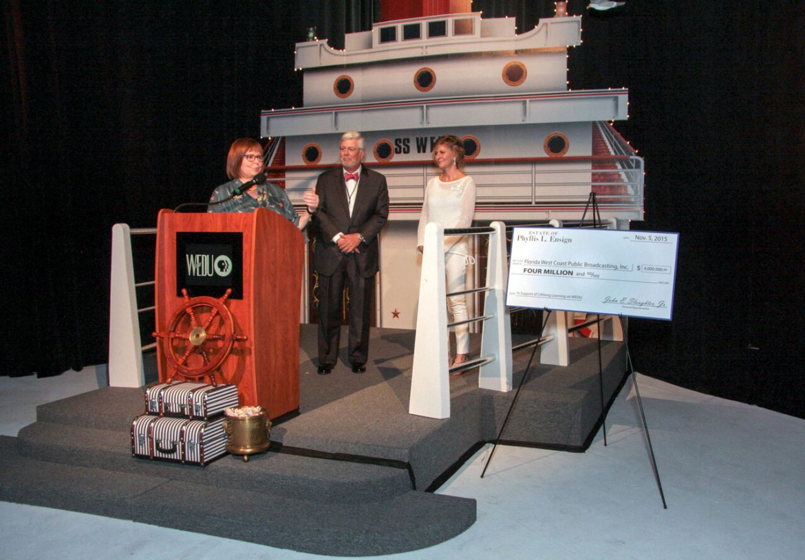 At last week's presentation ceremony, WEDU President Susan Howarth, at podium, and WEDU Board Chair Cathy Unruh accept the $4 million bequest from John Slaughter, donor Phyllis Ensign's attorney. (Photo: WEDU)