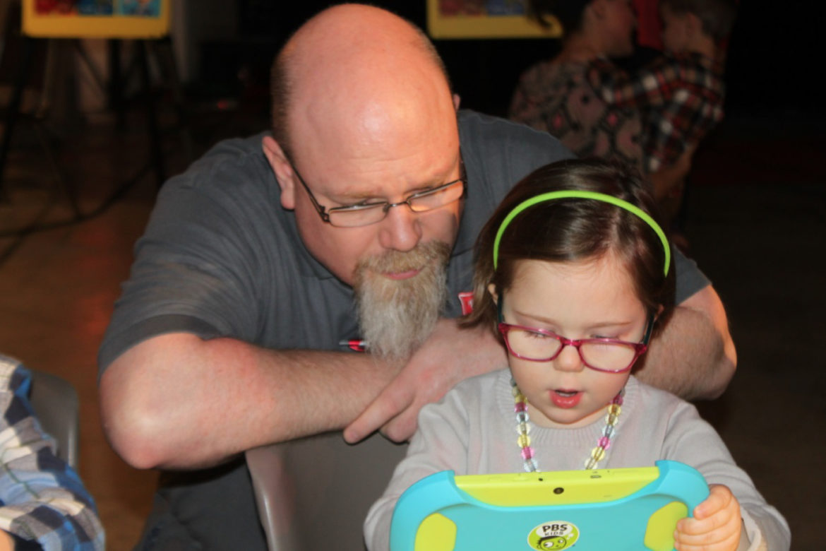 A father and daughter try out a PBS Playtime Pad at the station event. (Photo: WTVP)