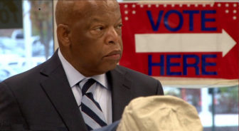 Rep. Lewis prepares to vote at his local polling station. (Photo: Courtesy Early Light Productions)