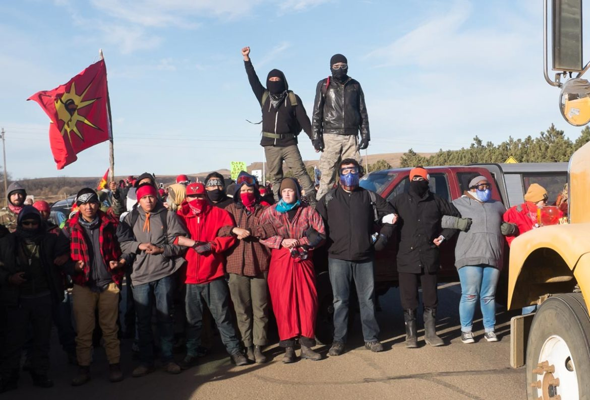 Standing Rock pipeline protestors block State Highway 6, near Mandan, Nov. 2016. Photo: Scott Carrier