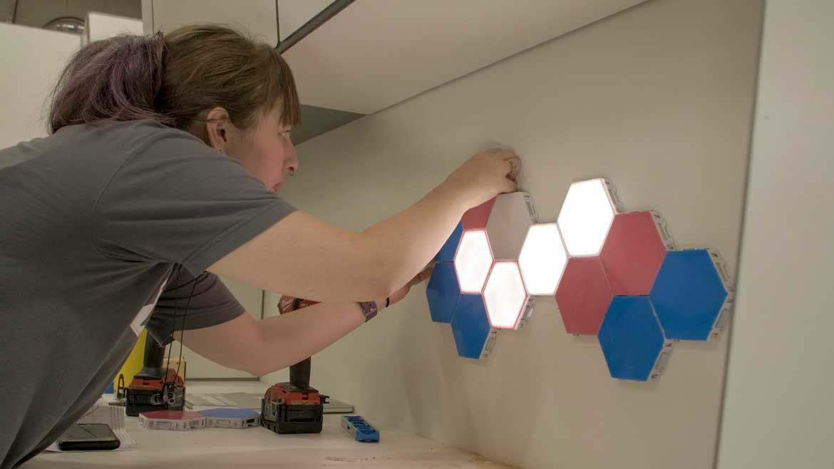 woman building wooden puzzle