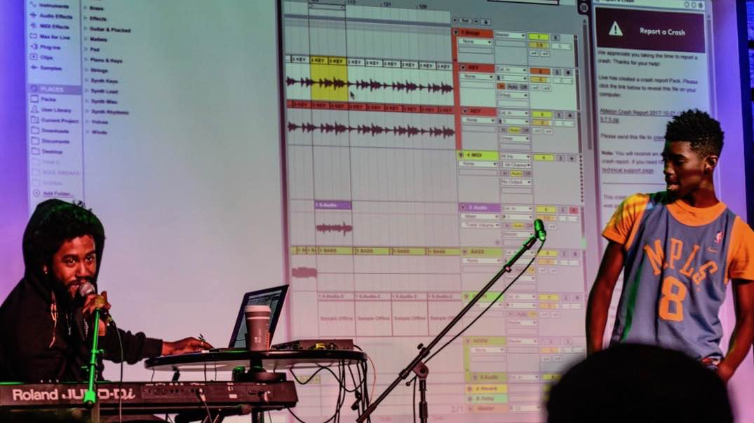 Producer Peter CottonTale gives feedback on students' samples at a Music Lab event in October 2017.