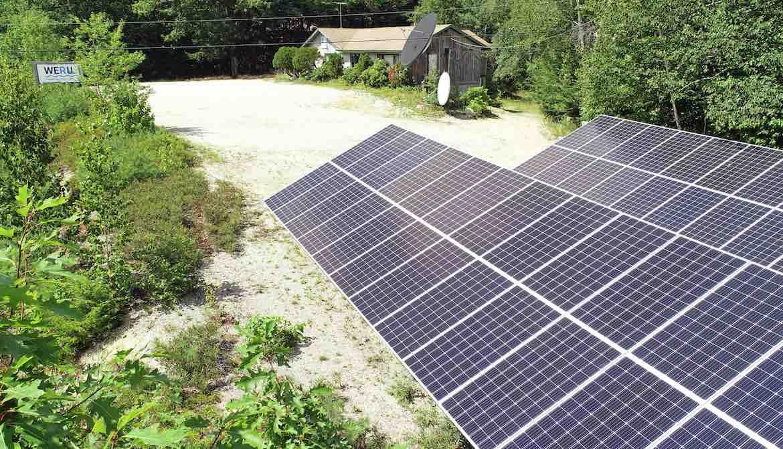 Solar panels in parking lot power studios of Maine's WERU-FM