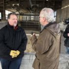 A reporter interviews a farmer for a Milwaukee PBS documentary