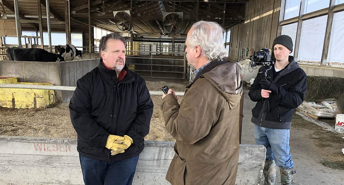 A reporter interviews a farmer for a Milwaukee PBS documentary