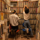 Two KDVS staffers browse the station's music library